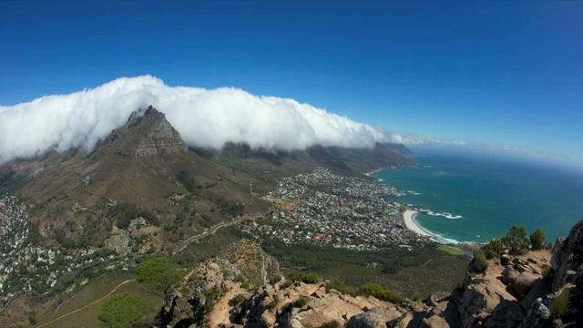 Table Mountain time-lapse by Eric Nathan. Panning HD time-lapse of the table cloth cloud effect over Table Mountain in Cape Town. Photographed from the summit of Lions Head using a Nikon D3. Full HD (1920 X 1080) version available.