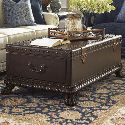 Features:  -Island Traditions collection.  -Set on a wood base with carved lion's paw feet and decorative carved rope molding.  -Leather-clad trunk features leather corner caps.  -2 sizes of nailhead