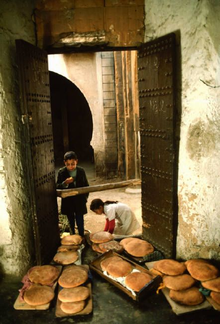MOROCCO. Fez. Bread brought to the oven. 1984. Bruno Barbey