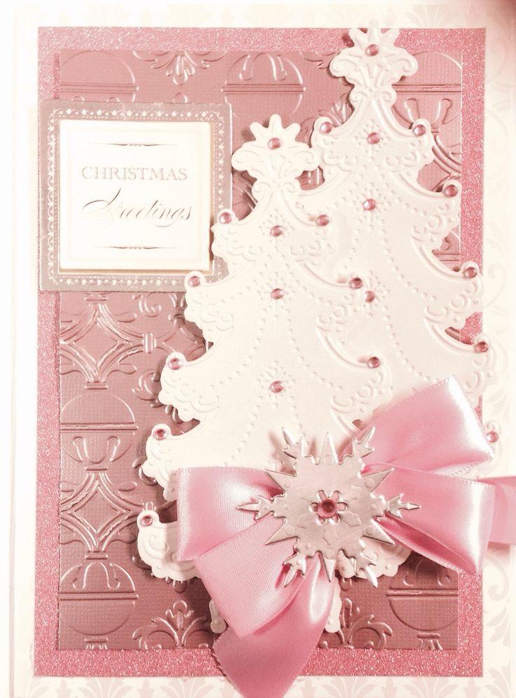 Pretty in Pink.  Anna Griffin Christmas tree embossing folder, Christmas tree die, snowflake die and jingle bell embossing folder.