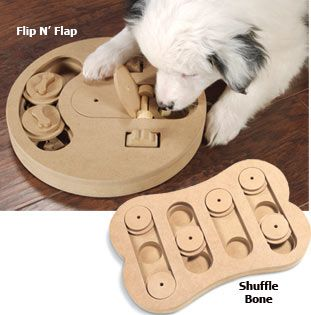 Puzzle Games for dogs with treats hidden within.  I wonder how quickly Ezio would figure this out and then be bored with it?