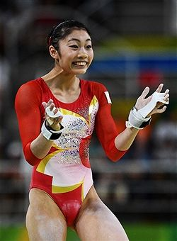 Yuki Uchiyama of Japan reacts after competing on the uneven bars during Women's qualification for Artistic Gymnastics on Day 2 of the Rio 2016 Olympic Games at the Rio Olympic Arena on August 7, 2016 in Rio de Janeiro, Brazil