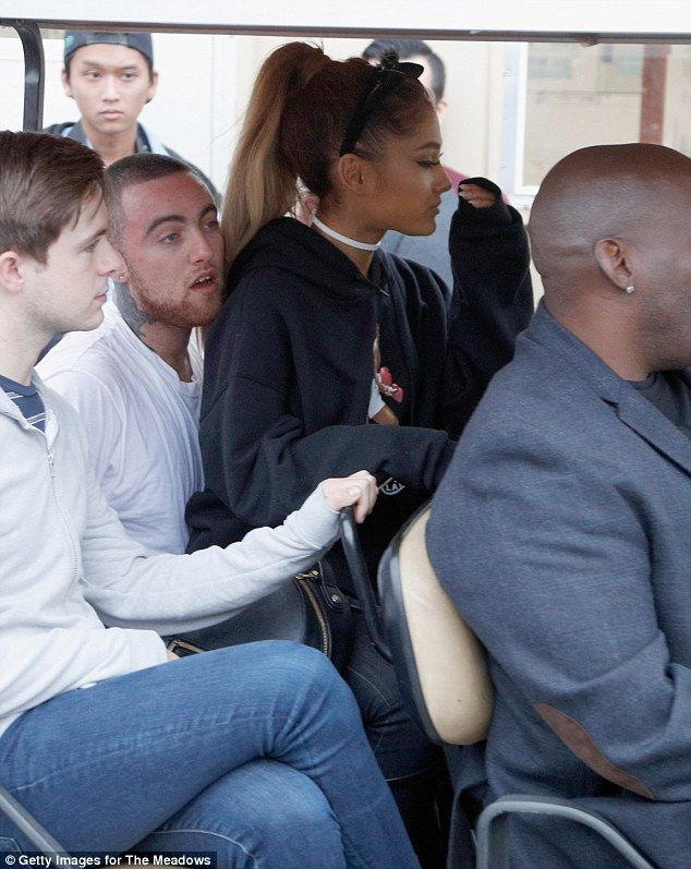 Cute couple: Ariana Grande sat on her new boyfirend Mac Miller's lap as they rode on a golf cart at the The Meadows Music & Arts Festival in Queens sunday