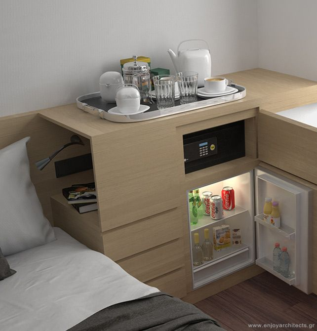 the smart side table by enjoy architects offers a sleek finish in this small hotel room
