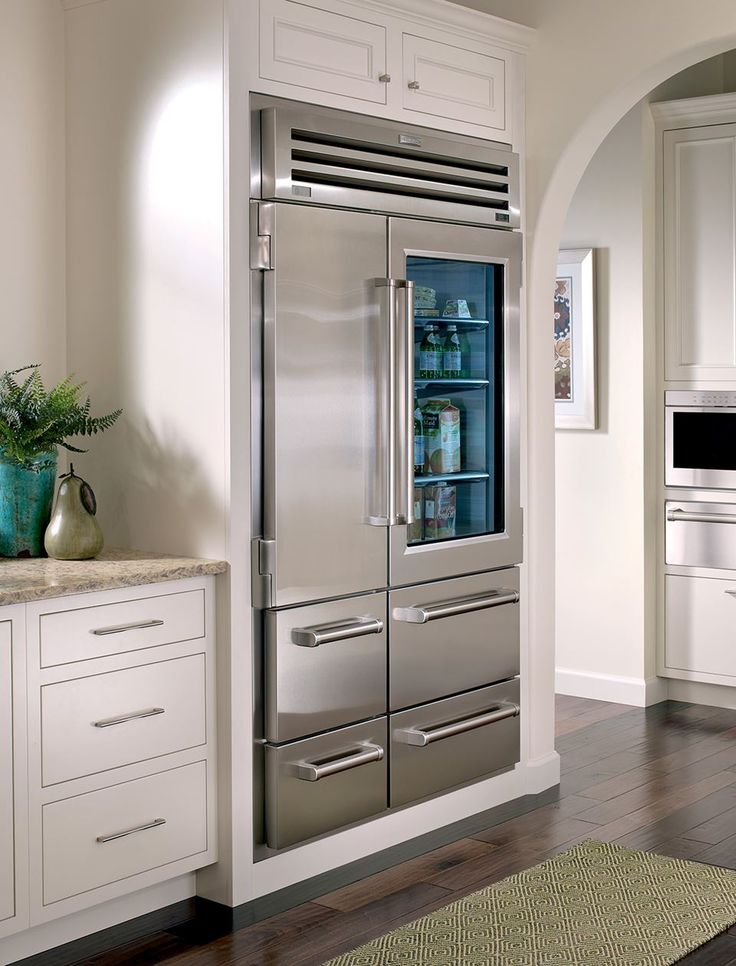 we are loving this beautiful and sleek kitchen featuring subzerowolf appliances