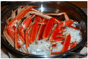 Boiled Crab Legs (my first attempt, yippee!)    To boil crab legs, simply fill a large saucepan half full of cold water and bring to a boil. Add a tablespoon of salt and the seasoning of your choice, if any. When the water begins to boil add the crab legs and reduce the heat to medium. Allow them to simmer for about six minutes. Take the crab legs out of the water, rinse and they are ready to eat.