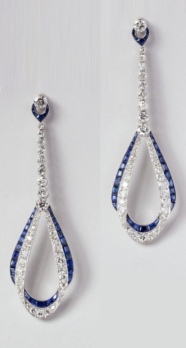 Van Cleef & Arpels - A pair of Art Deco diamond and sapphire earrings, circa 1924. In these elliptical earrings of 1924, Van Cleef & Arpels used a clever trompe l'oeil setting to give the appearance of overlapping loops of diamonds and sapphires that would have been seen with bobbed hair. #VanCleefArpels #ArtDeco