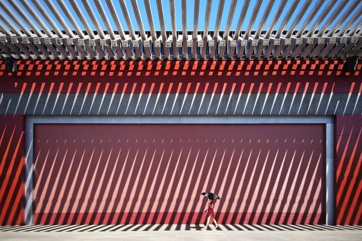 Winner, Mobile: The China Red. In front of this Chinese red wall walks a lady in a red dress. Photographed by Jian Wang.