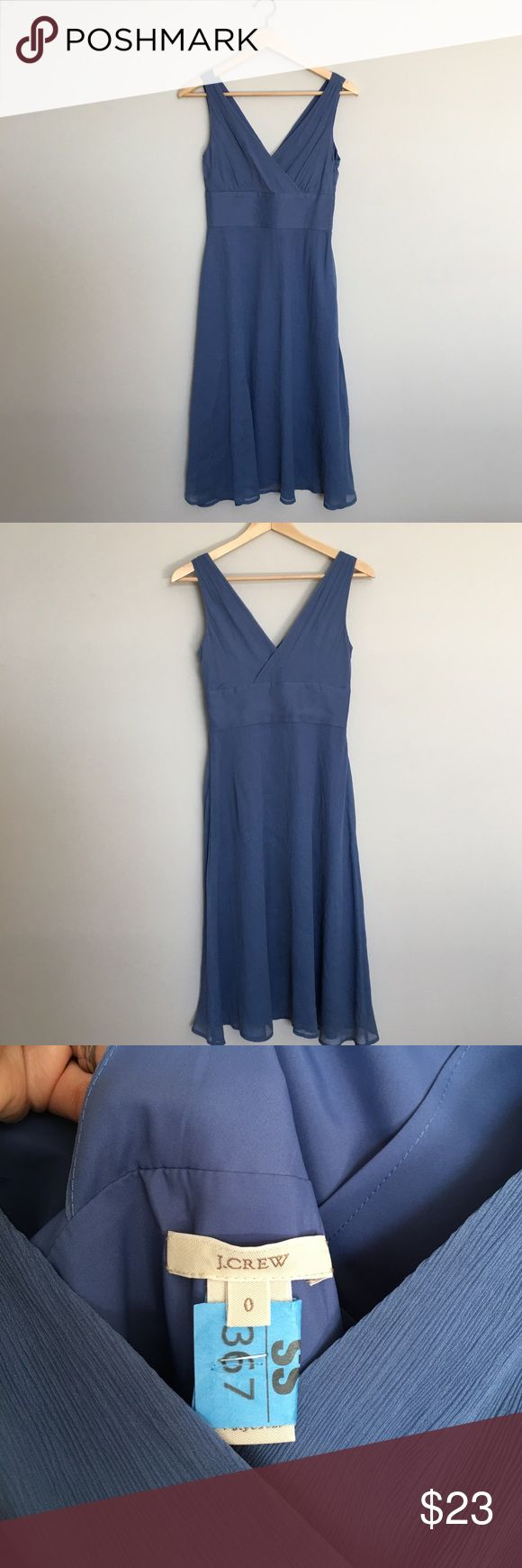 """J. Crew Blue Silk Sophia Dress Gorgeous Sophia dress from J. Crew in a beautiful steely blue. 100% silk and fully lined. Recently dry cleaned. Side zip. Size 0. Excellent condition except for a small spot on the front chest - see photo. Not very noticeable when on. Appx 42"""" long from top of shoulder. J. Crew Dresses Wedding"""