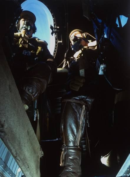 Fortune Color February 1942. Two pilots wearing US mil. leather flight suits & oxygen masks talking as they sit side- by-side in plane cockpit (no caps) during WWII. | Date: 1942 | Photographer: Dmitri Kessel | LIFE archive - Hosted by Google