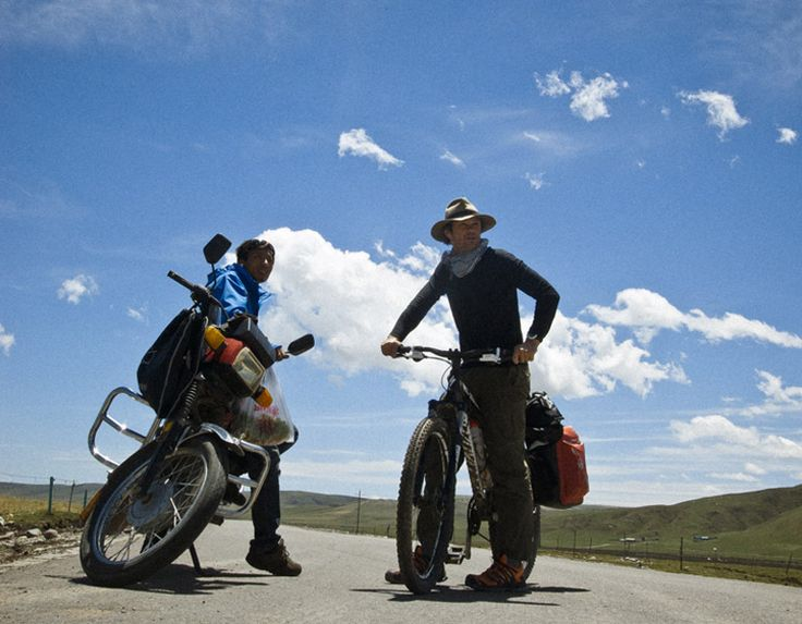 Julian Wison looks out at a village in Qinghai after a long, adventurous ride.   www.khunu.com