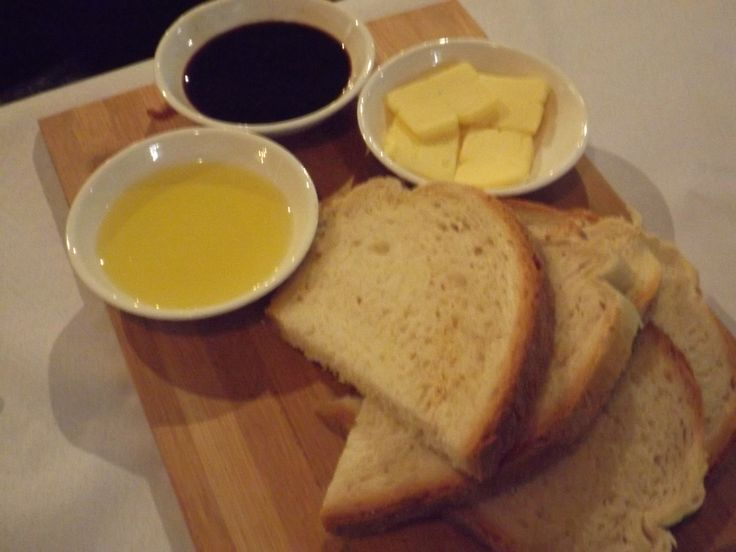 Our fresh, complimentary bread served with real butter, olio & balsamic.  Food with Love at Zia's ♥
