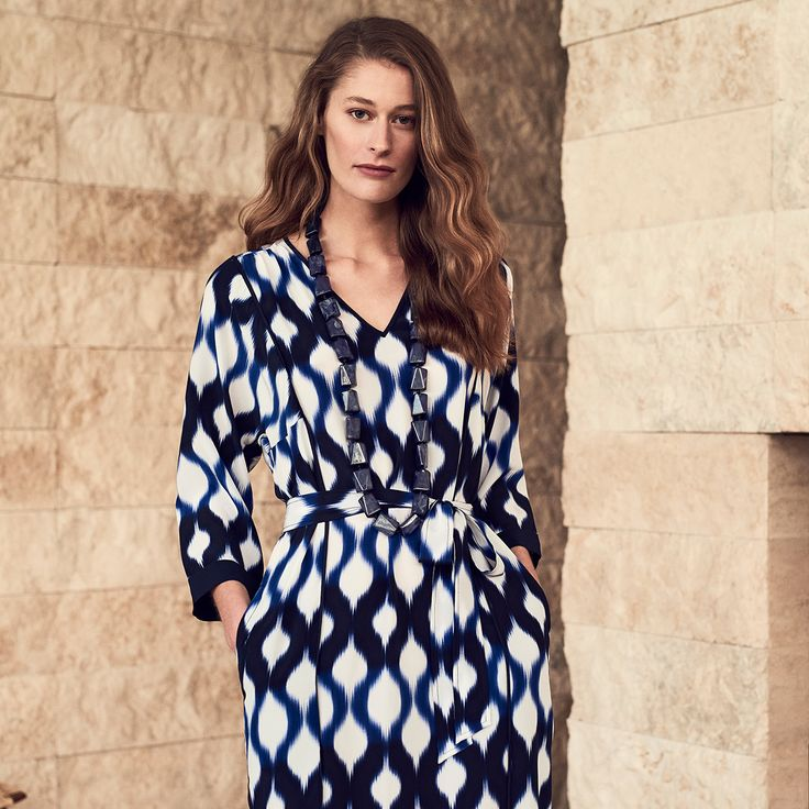 This dress is cut from pure silk crêpe de chine with a beautiful navy and blue toned ikat print. Featuring a flattering v-neckline and trimmed in solid navy silk, use the self-belt to cinch it in at the waist.
