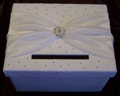 wedding card holder - I like the idea of the ribbon and brooch