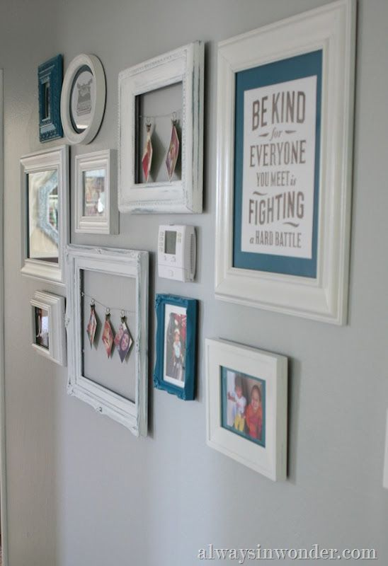 Cute gallery wall that includes the thermostat so it doesn't draw attention - LOVE the frame with wire across and snapshots hanging from little clips! would work for kids artwork too. or cards...