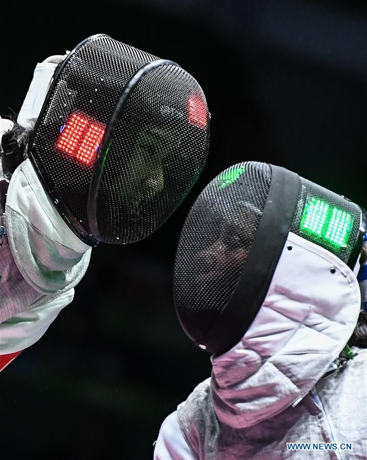 China's Liu yongshi competes with Hungary's Edina Knapek during a women's foil individual table of 32 fencing match at the Rio 2016 Olympic Games in Rio de Janeiro, Brazil, on Aug. 10, 2016.  http://infoseekchina.blogspot.com/2016/08/weekly-xinhua-photos-aug-8-aug-14.html