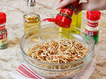 Coat whole grain pasta with a light drizzle of olive oil and balsamic vinegar and toss with garlic powder, basil and crushed red pepper.