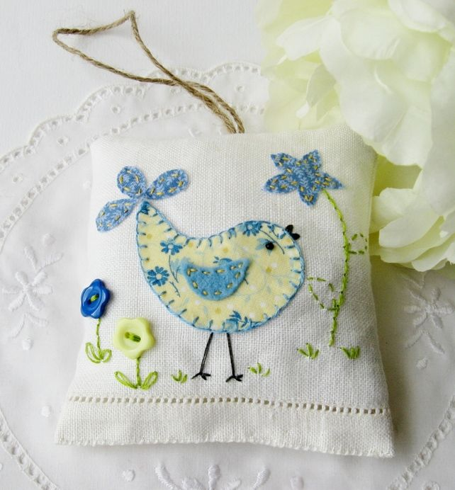 bird design in floral fabric applique with button flowers and embroidery. The bird has a little black bead for his eye, and a blue felt wing. Filled with polyester filling and a generous amount of dried lavender flowers ,, ♥♥♥ it! (replace top flower with crochet)