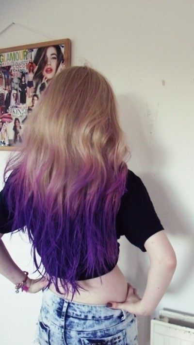 Messy blond hairstyle with purple dye dip