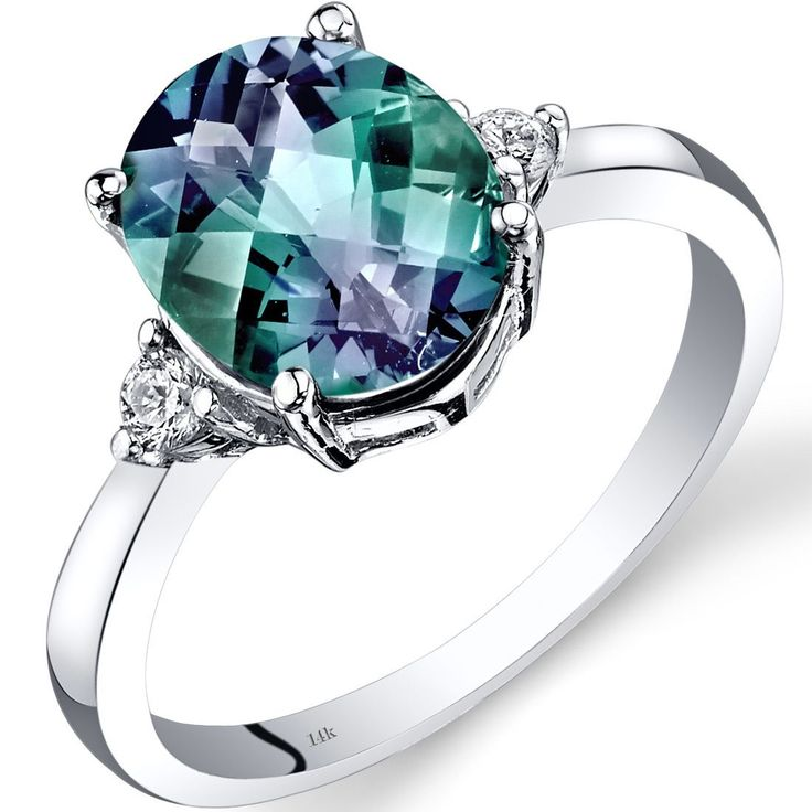 This ring features an exceptional design, with detailed craftsmanship and finishing touches. The centerpiece of this beautiful ring is a 3.00-carat oval cut created alexandrite. This 14-karat white go