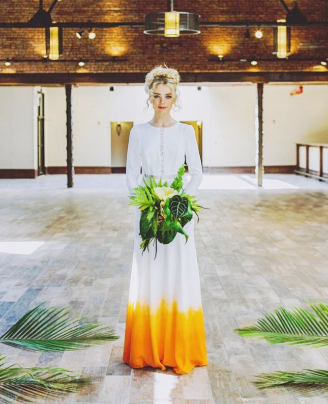 Non-traditional brides, bookmark this dip-dyed orange wedding dress as inspo for your own colorful gown option.
