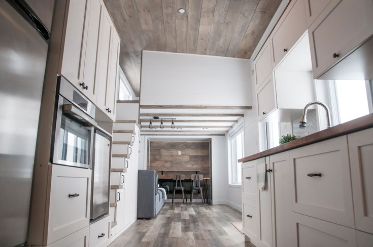 The Ébène is our 7th custom tiny house on wheels. This park model tiny house is 10 ft wide x 36 ft long, and you can find all the appliances you normally find in a standard house.