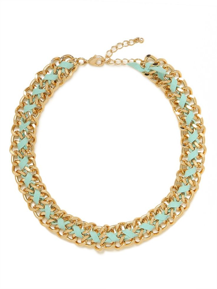 This statement necklace marries the luxe glamour of gold chain links with a quick hit of color in the braided suede strands. The look is cool and oh-so-DIY-chic.