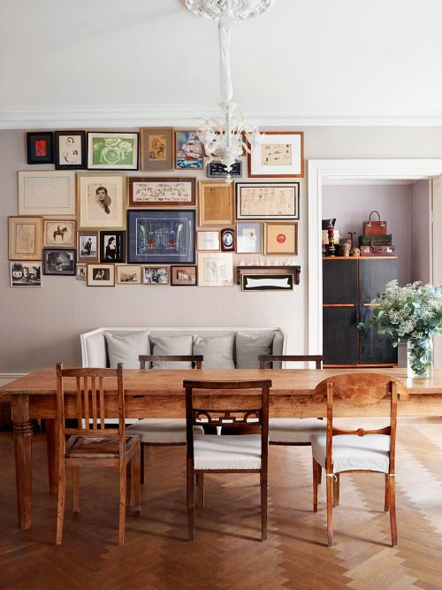 gallery wall and mismatched dining chairs