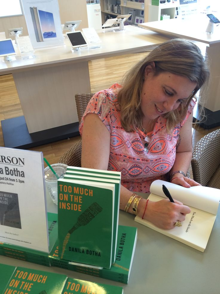 """Danila Botha, author of Too Much on the Inside"""" signing books."""