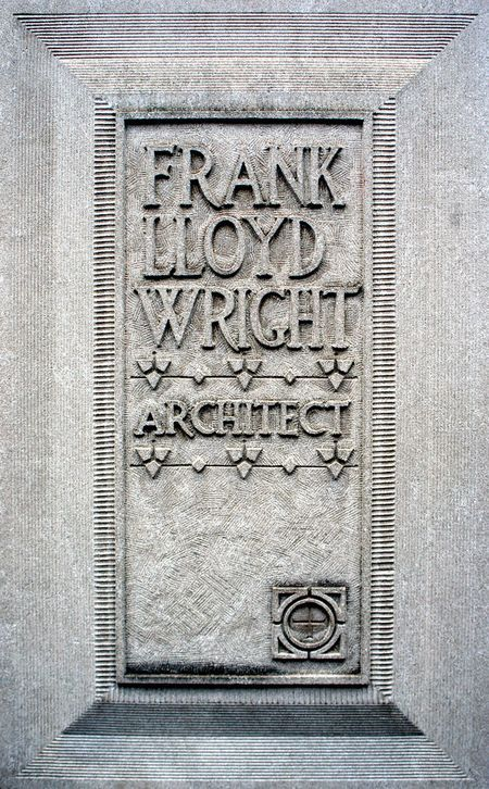 Frank Lloyd Wright's cast concrete lettering advertising his architectural and design practice in front of the office portion of his home and studio in Oak Park, Illinois.