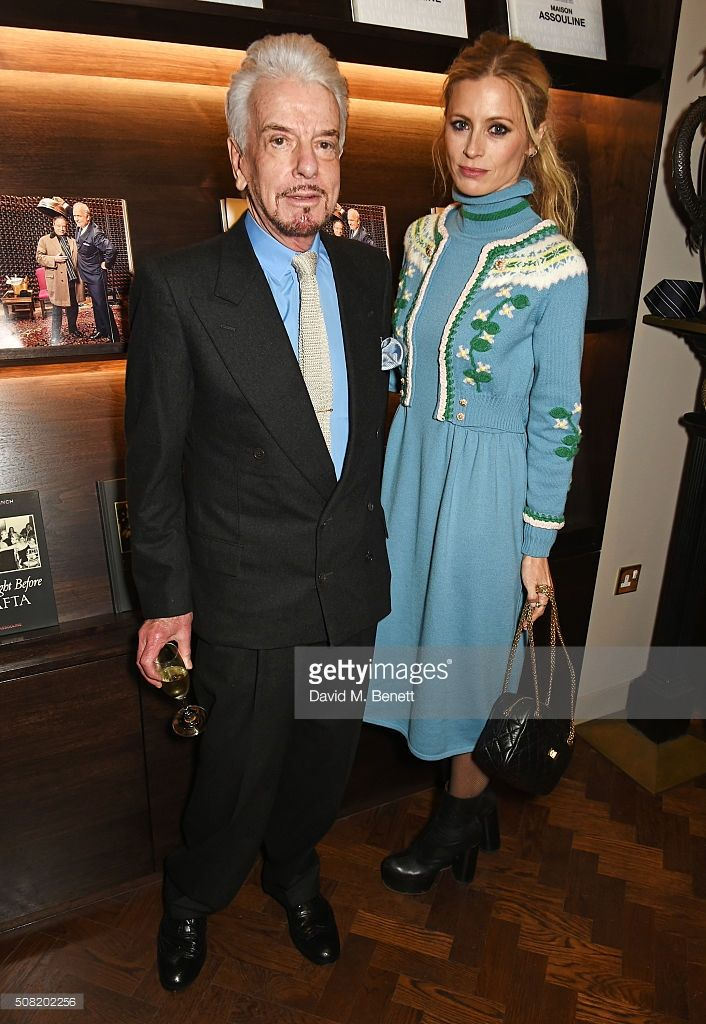 Nicky Haslam (L) and Laura Bailey attend the launch of 'The Night Before BAFTA' by Charles Finch at Maison Assouline on February 3, 2016 in London, England.