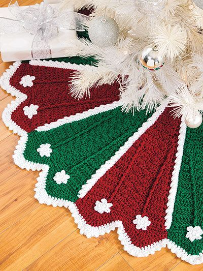 A Crochet Christmas  - A Crochet Christmas is a book of tree trims and festive holiday decor, all stitched using thread and a variety of different yarn weights. A great holiday project book for crocheters of all skill levels. Over 30 designs, including ornaments, tree skirts, doilies, angels, penguins, snowmen, Santas, afghans and more. | download crochet patterns | Christmas tree skirt crochet pattern | easy Christmas crochet patterns | Crochet for Christmas