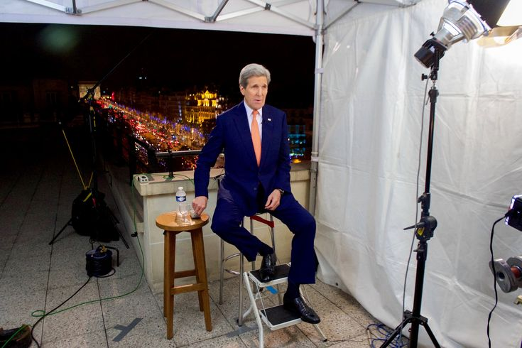 https://flic.kr/p/BzqsDV | Secretary Kerry Tapes A Series Of Sunday News Program Interviews Following The COP21 Climate Change Conference | U.S. Secretary of State John Kerry adjusts the volume in his earpiece as he sits above the Champs Elysees and the Arc de Triomphe in Paris, France, on December 13, 2015, before taping a series of four Sunday news program interviews following the COP21 climate change conference. [State Department photo/ Public Domain]