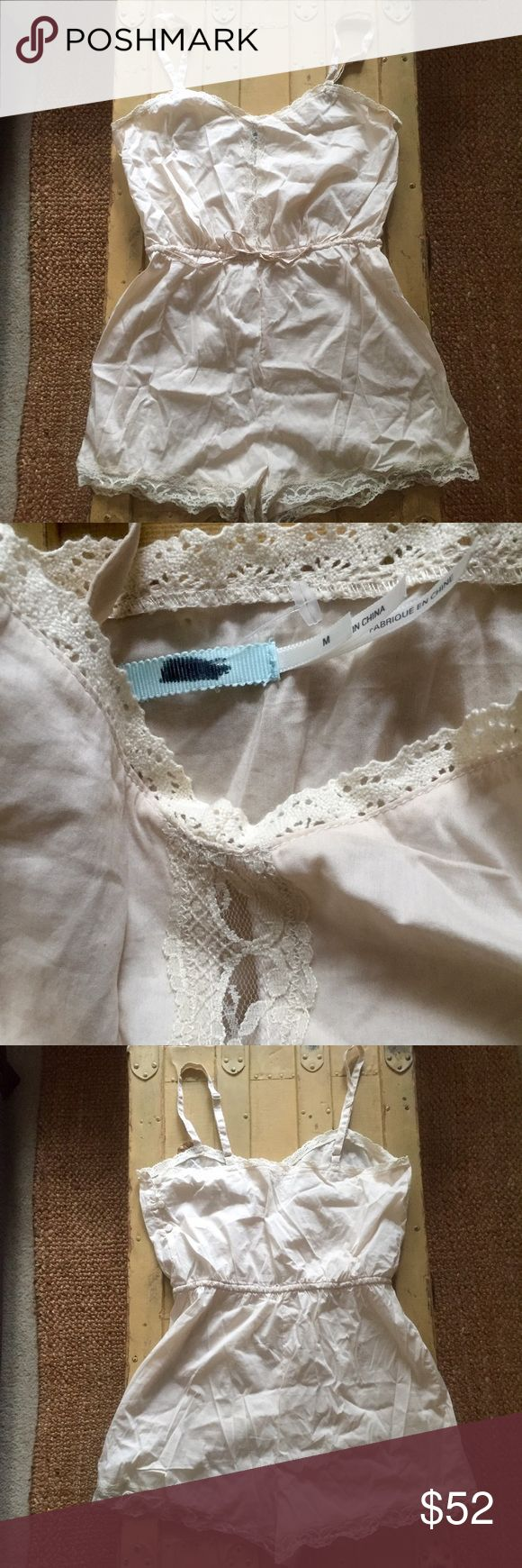 NWOT URBAN OUTFITT KIMICHI BLUE CROC LACE ROMPER M NWOT URBAN OUTFITTERS KIMICHI BLUE BRAND CREAM CROCHET LACE ADJUSTABLE CINCH WAIST ROMPER WMNS SZ M $78 100% Authentic URBAN OUTFITTERS KIMICHI BLUE BRAND Size: WOMENS size M (REG) Color: Cream Condition:  New without tags, store display; tag has been marked through to prevent store return;*see photos for specific detail Material: 65% cotton, 32% nylon, 3% spandex RN number: 66170 Combined shipping discount with purchase of additional items…