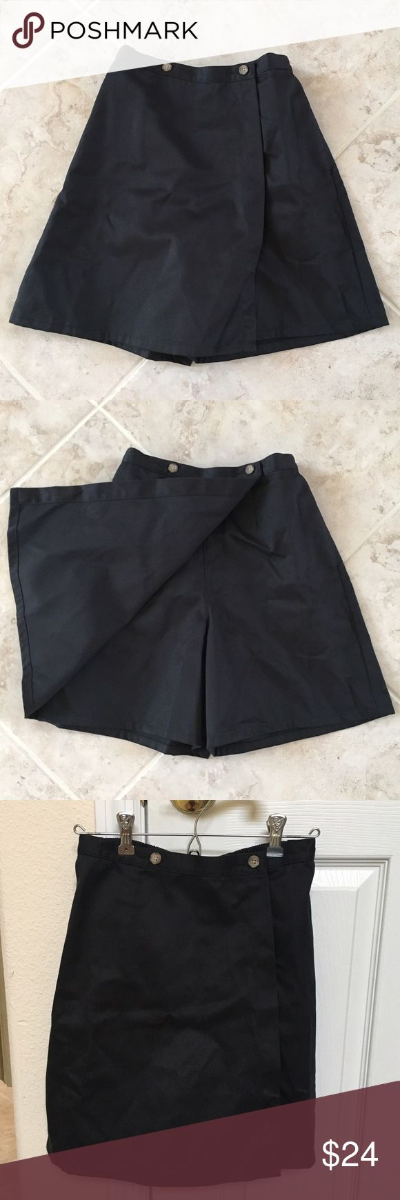 Black Skort From Lands End School Uniform Size 16S Girls Black Skort From Lands End School Uniform, Size 16S NWOT.  Brand new Black skort from Lands End.  Looks like a skirt with hidden shorts for comfort & coverage.  Pull-on style with a back elastic waist for added ease.  Includes side pocket.  Universal school uniform.  Above-the-knee length.  Size 16 Slim Girls uniform.  65% Polyester & 35% Cotton.  New name tag is attached.  From clean smoke-free home. Lands' End Bottoms Skorts