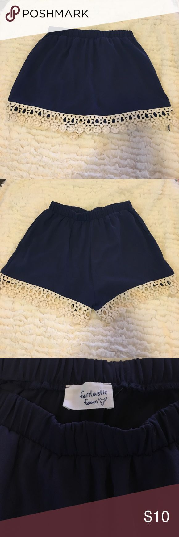 Lace trim skirt/skort 💖 Navy blue skirt with white lace trim skirt/skort! Skirt in the front, shorts in the back. Never been worn, from a boutique 💜 Skirts Mini