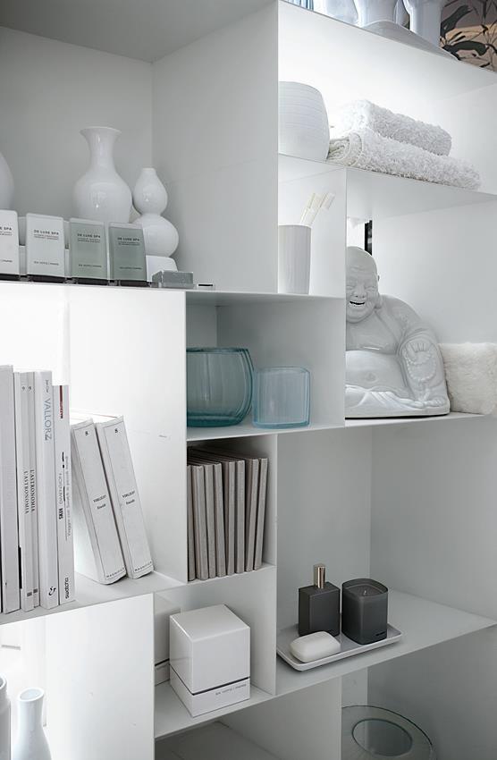 Sleek white metal shelves.