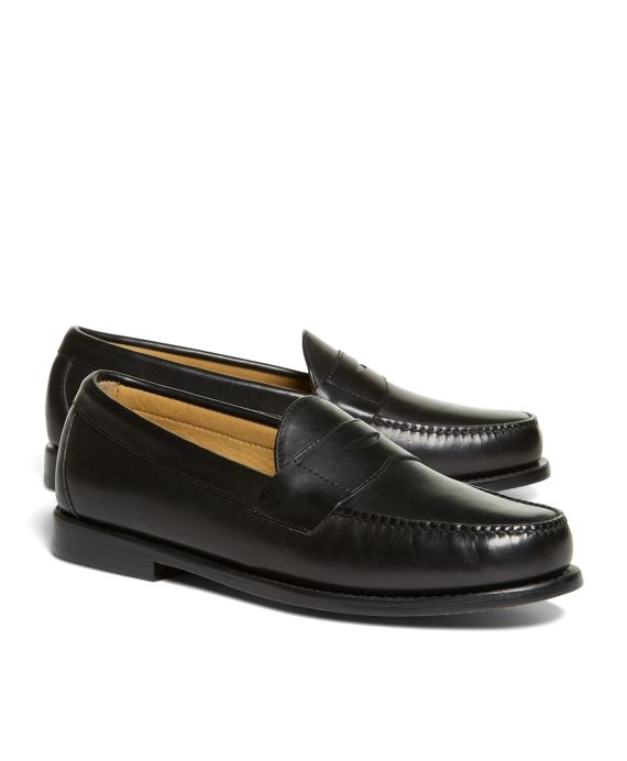 Classic penny loafers, made from calfskin leather. Leather sole. Leather lining. Tone-on-tone stitching. Imported.