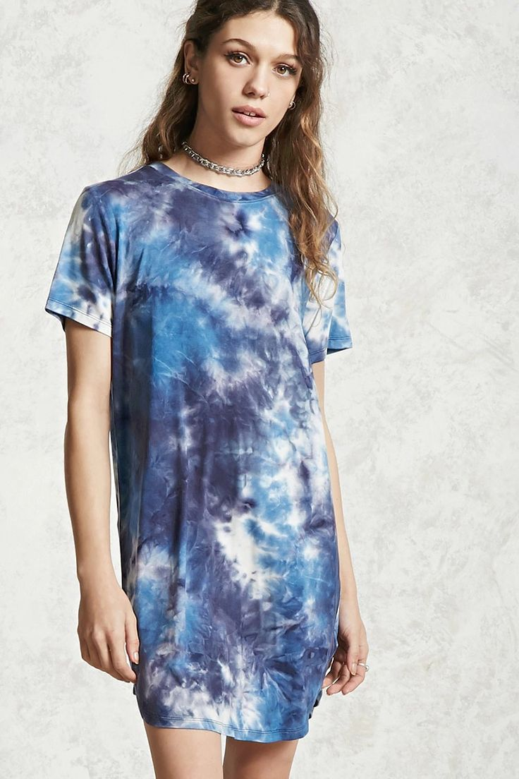 A soft knit T-shirt dress featuring a tie-dye wash, a ribbed crew neck, short sleeves, a slightly curved hem, and a swing silhouette.