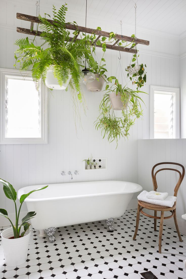 Heritage-style bathroom from a renovated Queenslander home transformed with eclectic luxe style. Photo: Elouise Van Riet-Gray | Story: homes+