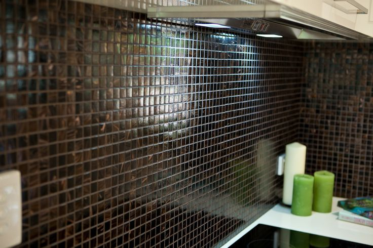 Small tiles make an excellent feature in kitchens and bathrooms. www.onecallkitchens.com.au
