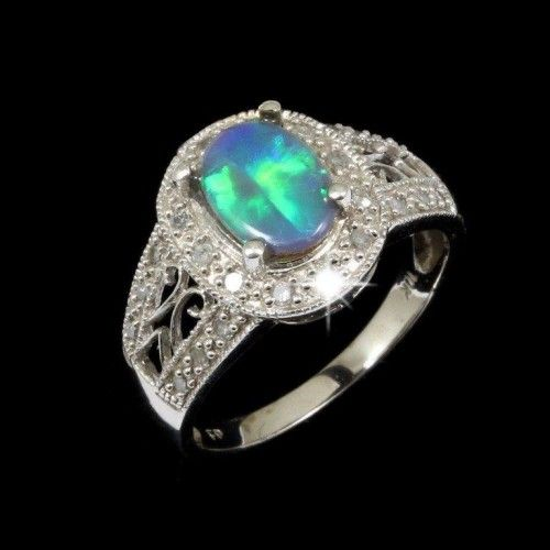 flashy dark opal ring surrounded by 24 diamonds, set in 10k white gold. A stunning piece from the famous Lightning Ridge field in Australia