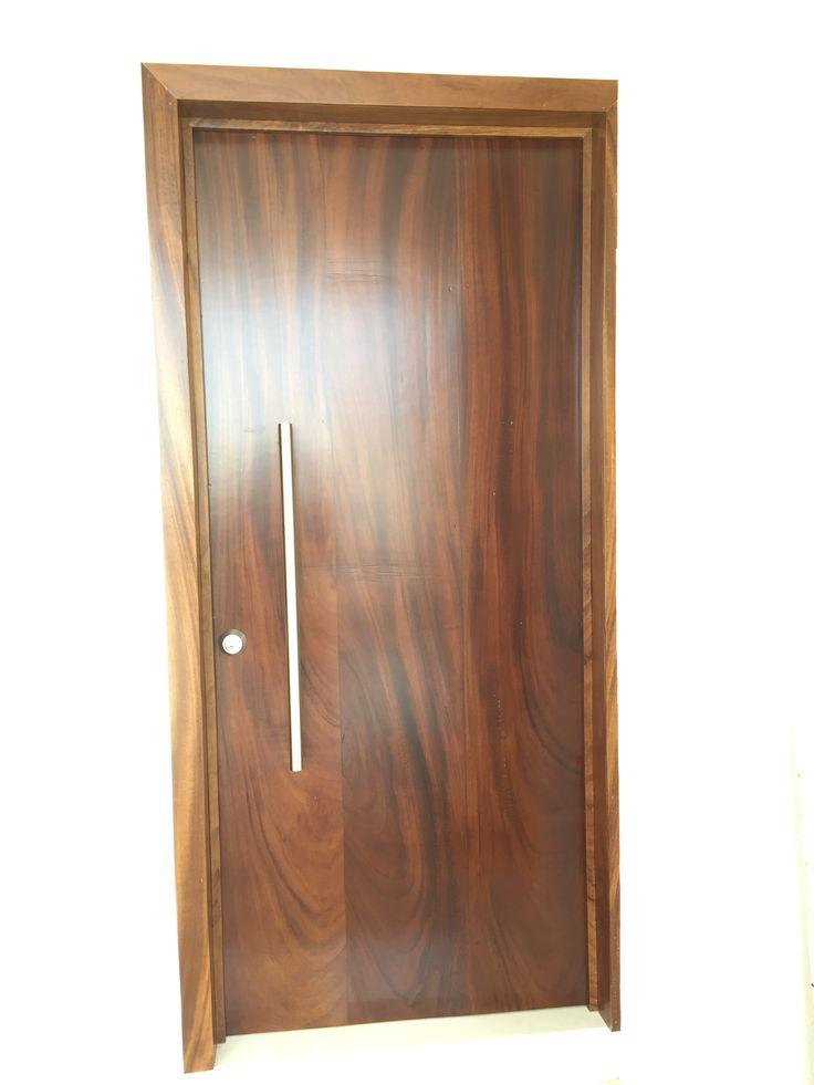 Puerta principal en madera de parota puertas langarica for Puertas de herreria forjada