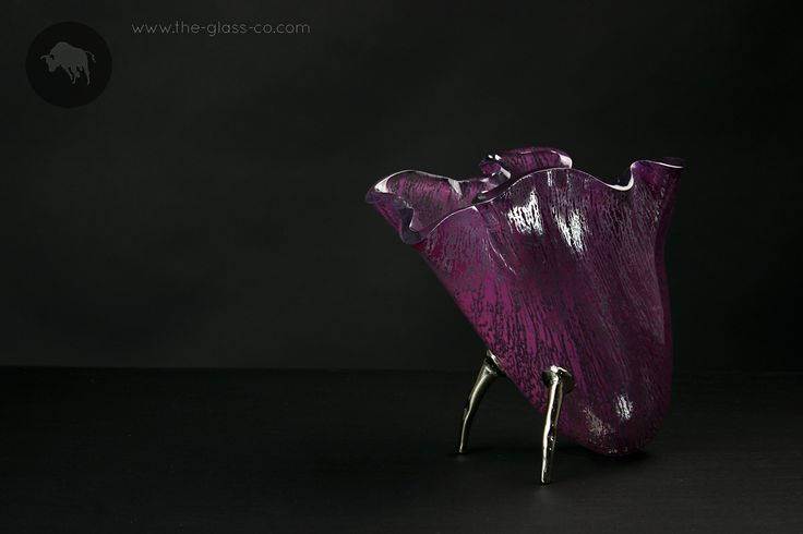 Purple tilted vase on metal supports designed by Glass Studio