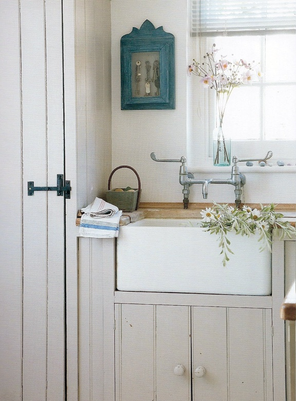 This is absolutely gorgeous for a small cottage kitchen. I would love this as a mudroom or laundry room too.