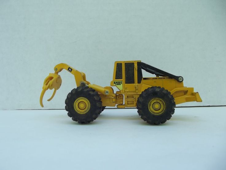 59a540a24023bc78e0a53d9574bb1f01 logging equipment john deere vintage ertl cub cadet lawn tractor diecast toy w plow and trailer  at mifinder.co