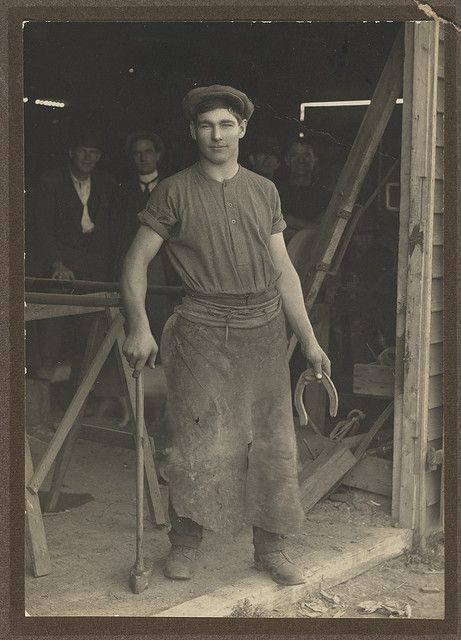 """Les Darcy at the blacksmith shop door"", East Maitland, ca. 1910 / Victor Studios"