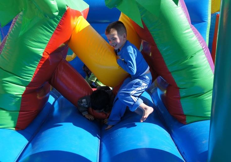Kids having fun on the adventure island jumping castle