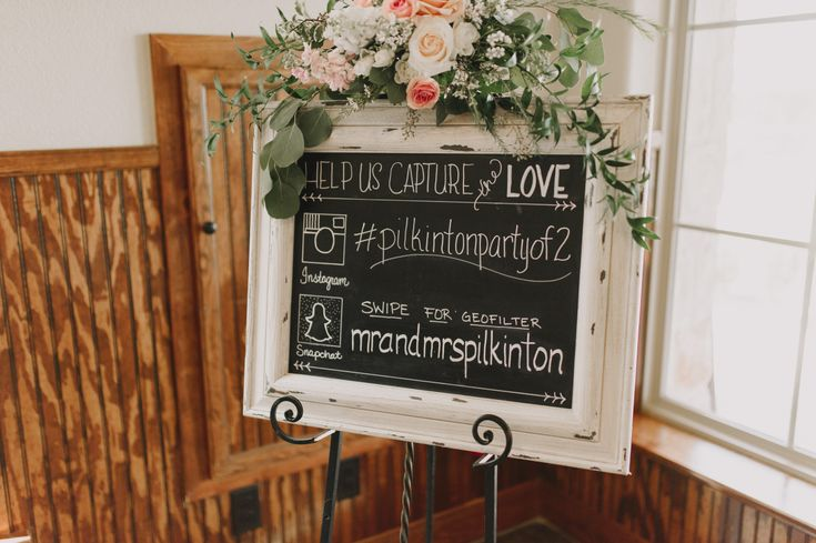 "An elegant social media wedding sign for your blush pink wedding reception!  A white-framed chalkboard with a blush pink floral swag on top that reads:  ""Help us capture the love.""  Make sure to include your Instagram hashtag + whether or not you have a Snapchat geofilter! Photo taken at THE SPRINGS Event Venue.  Follow this pin to our website for more information, or to book your free tour! SPRINGS location:  Tuscany Hill in McKinney, TX Photographer:  Ashley Wright Photography #weddingsign"