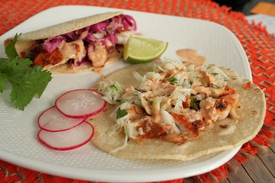 Blackened Tilapia Fish Tacos with Chipotle Aioli Sauce Recipe Main Dishes with red cabbage, cabbage, carrots, sugar, white distilled vinegar, coconut oil, celery seed, salt, shredded cabbage, chopped cilantro, lime juice, vegetable oil, salt, crema mexicana, chipotles in adobo, adobo sauce, sweet onion, salt, paprika, Mexican oregano, garlic powder, sea salt, ground cumin, red pepper, honey, lime juice, tilapia fillets, cooking spray, corn tortillas, lime wedges